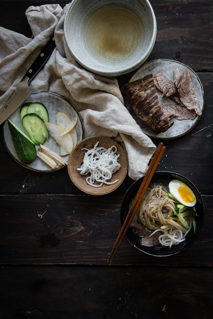 mul naengmyeon (korean cold noodles) | two red bowls