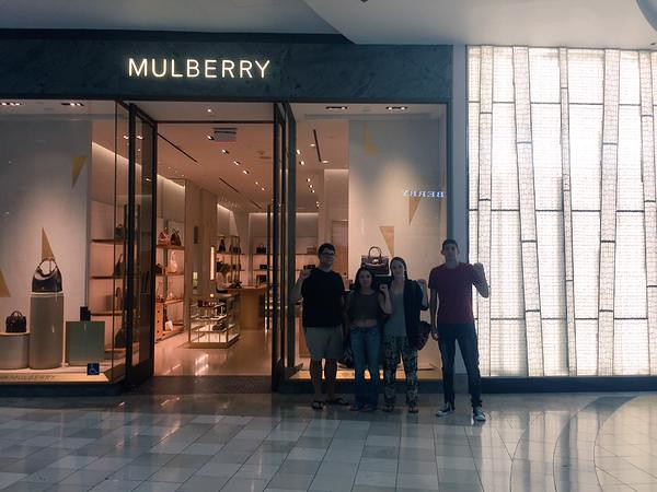 Students stand in front of a Mulberry store in solidarity with workers