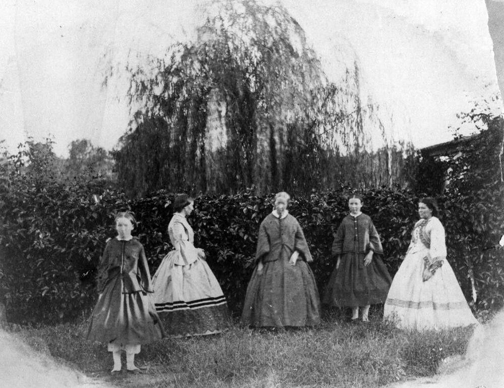 Group of women and girls in the garden, 1860-1870