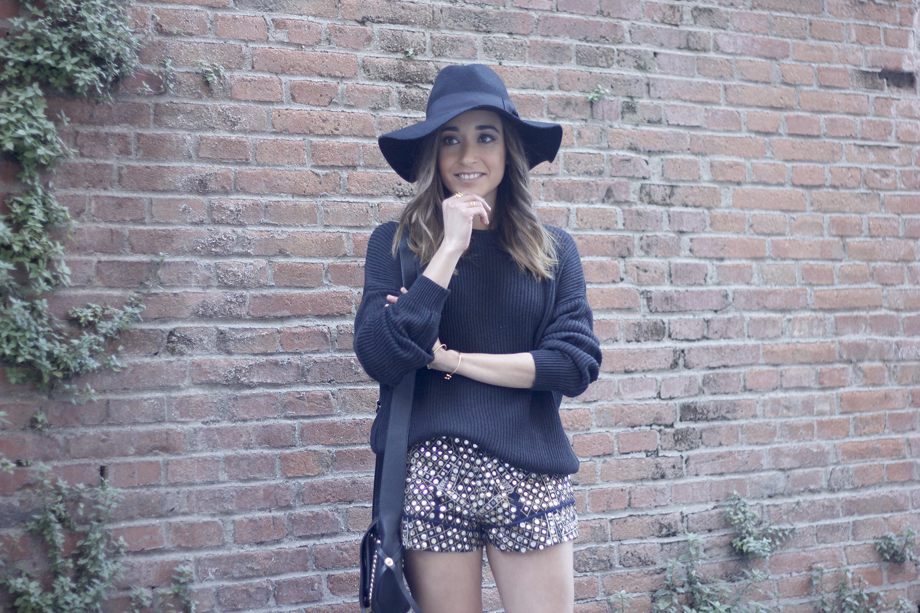 embroidered shorts black hat over the knee boots black sweater pull and bear purse coach outfit09