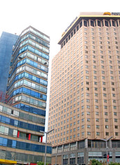 residential area(0.0), plaza(0.0), tower block(1.0), metropolitan area(1.0), building(1.0), skyscraper(1.0), property(1.0), commercial building(1.0), headquarters(1.0), brutalist architecture(1.0), real estate(1.0), condominium(1.0), facade(1.0), downtown(1.0), neighbourhood(1.0),