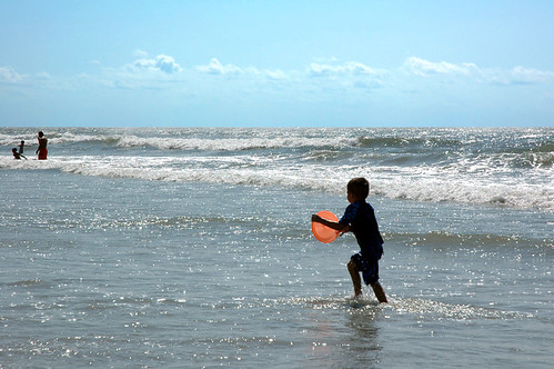 ocean blue boy sea sky people orange sun beach silhouette kids clouds contrast fun nc kid waves candid north d70s northcarolina run sparkle utata myrtle frisbee northmyrtlebeach utatasilhouette