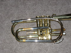 sousaphone(0.0), tuba(0.0), trombone(0.0), saxhorn(0.0), baritone saxophone(0.0), helicon(0.0), horn(0.0), euphonium(0.0), types of trombone(0.0), alto horn(0.0), trumpet(1.0), brass instrument(1.0), wind instrument(1.0),