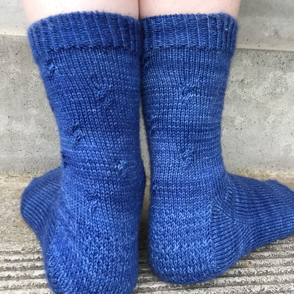 blue tip top toe socks from behind. showing off delicate and sparse cable detail