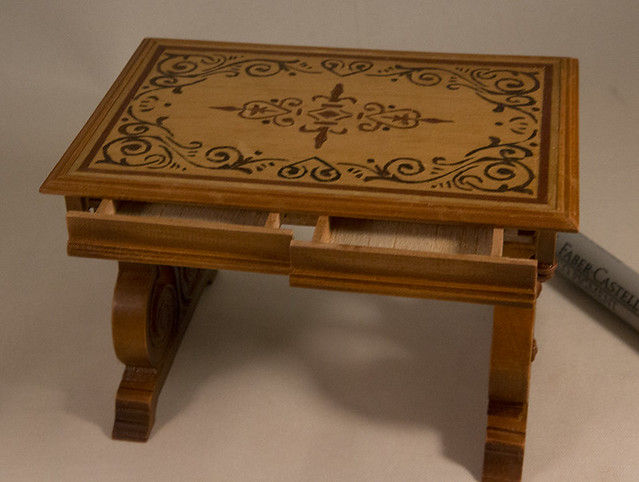 Tuscan table with marquetry top