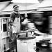 tsukiji market worker in the rain by Joits