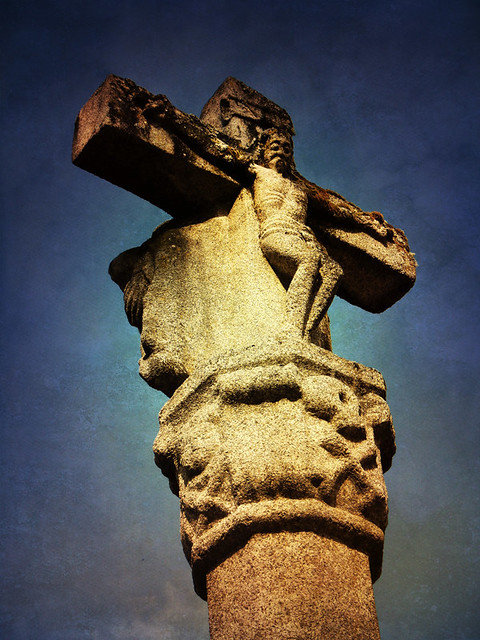 A stone cross outside the restored monastery at the Sacred Shore in northern Spain