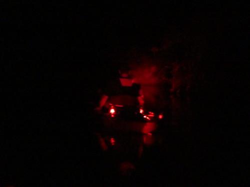 Pedal kayak at night.