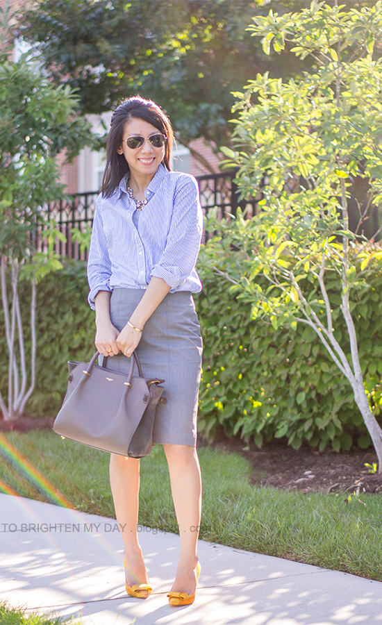 jeweled necklace, blue stripe button up shirt, gray pencil skirt, mustard yellow bow pumps