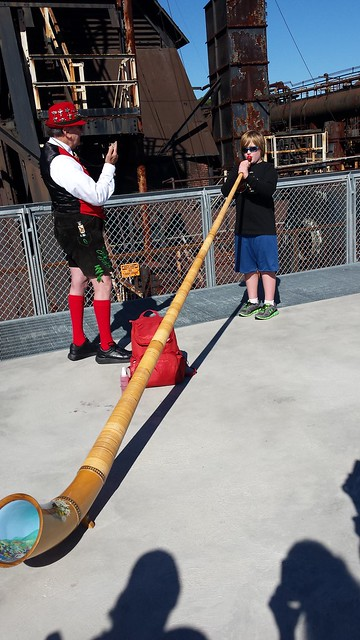 Blowing the Alpine horn