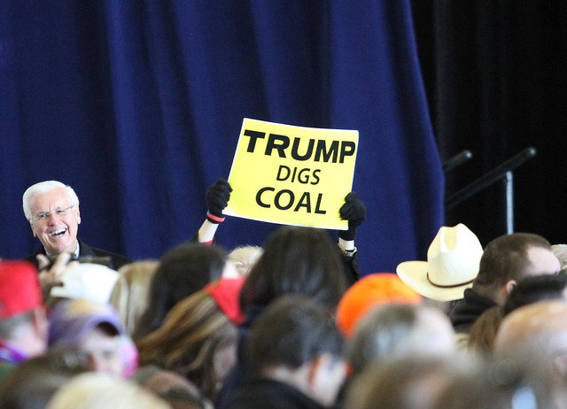 photo of trump digs coal sign