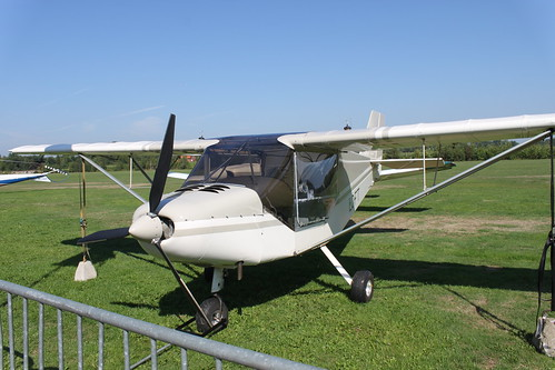 small plane standing on grass
