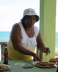 Server at Sandy Beach Restaurant, Hoskins Belize