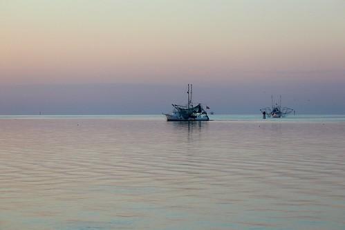 morning autumn sea usa gulfofmexico sunrise mississippi boats dawn october unitedstates ripples fishingboats shores sounds coasts oceansprings gulfs southernstates mississippisound gulfcoastregion
