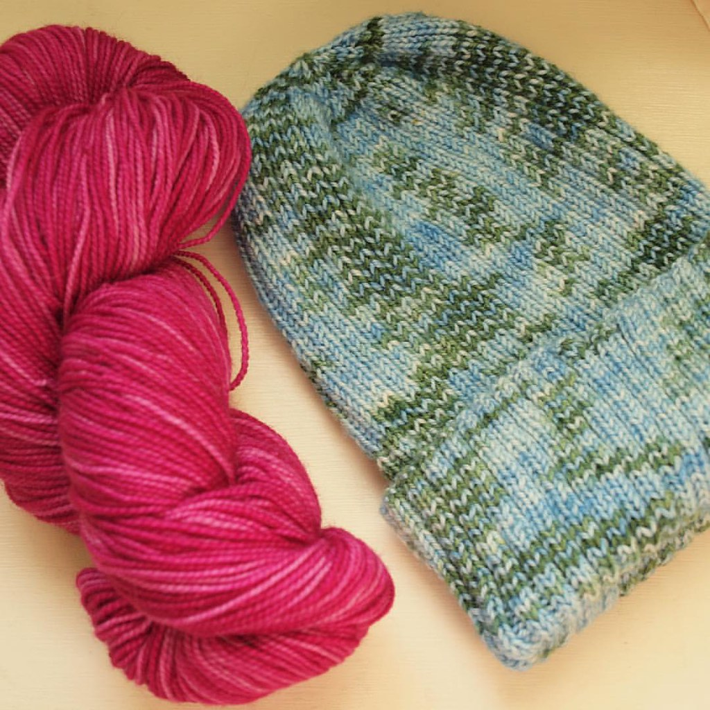 "Finished hat (in time for Equinox celebrations!), plus the skein through which I hope to ""purchase"" said hat from M :)"