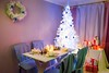 Breathtaking Christmas table setting with present and tree