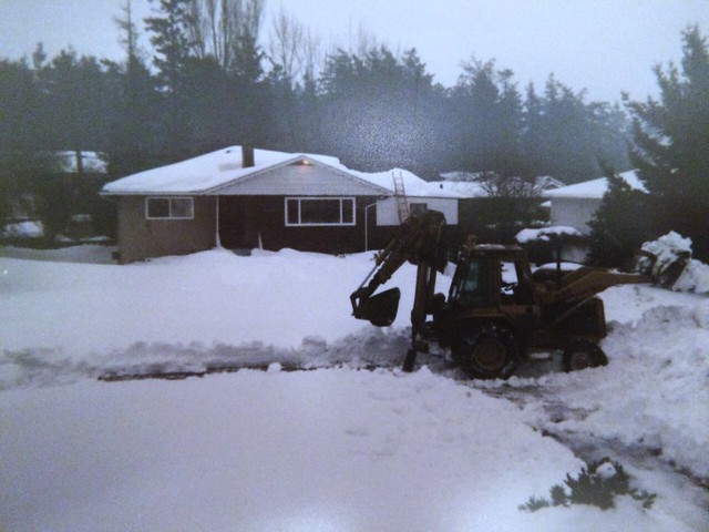 Vanalman Avenue, Saanich. Photo David Antrobus. The backhoe belonged to a neighbour who owns Eagle Excavation.