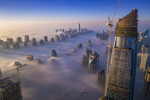 nisifilters dubai dubaimarina fog sunrise sky air sun sunlight skyscrapers town city metropolis towers futuristic heaven