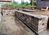 Brick retaining wall and bench completed by Canadian Dragon