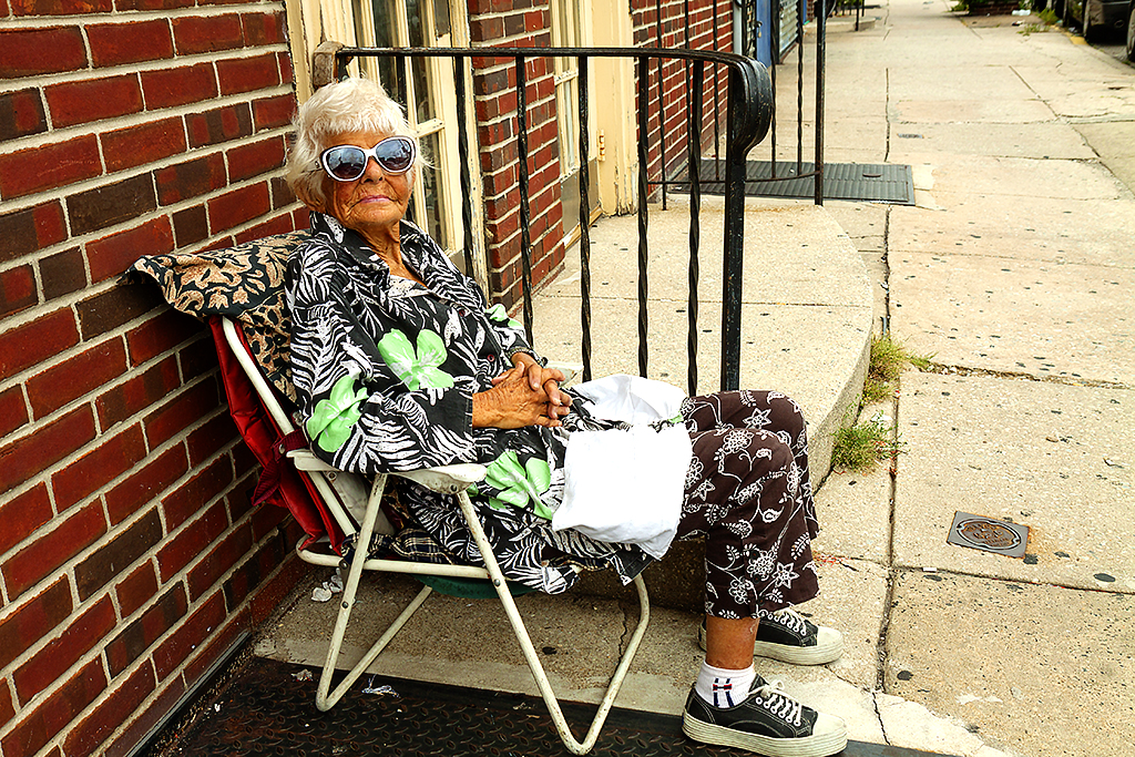 Woman sitting outside door on 9-12-15--Bella Vista