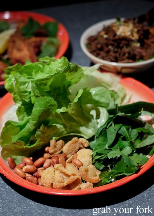 Lettuce, peanuts, pork crackling and herbs for the larb kua Northern Thai style DIY sang choy bao at Chung Tang, Chatswood