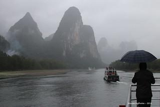 Atmospheric Limestone karsts in the mist & rain - Li River Guangxi China