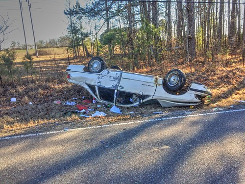 Power Pole Impact Triggers One Car Rollover