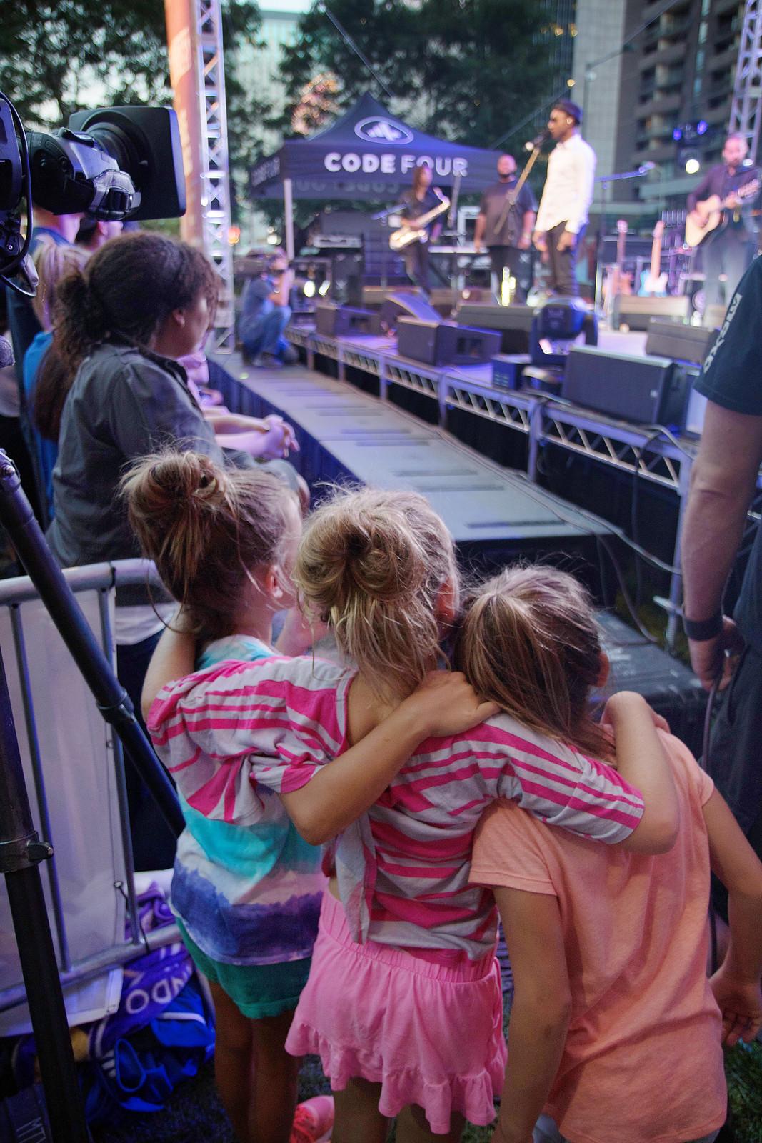 Girls hugging at a Denver concert