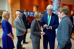 U.S. Secretary of State John Kerry tests an app created by a Fishackathon participant in between sessions of the Our Ocean Conference 2015 in Valparaíso, Chile, on October 5, 2015. [State Department photo/ Public Domain]