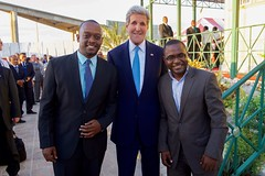 U.S. Secretary of State John Kerry and Haitian social media leaders Carel Pedre and John Fritz Moreau pose for a photo in Port-au-Prince, Haiti, on October 6, 2015. [State Department photo/ Public Domain]