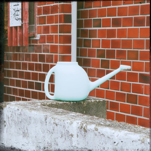 Blue plastic watering can