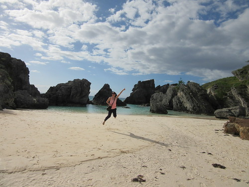 Mei jumping at Horseshoe Bay Beach in Bermuda.
