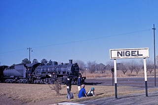South African Railways Class 24 steam locomotive No 3644 arriving at Nigel on a down passenger train service from Springs, Transvaal, South Africa.