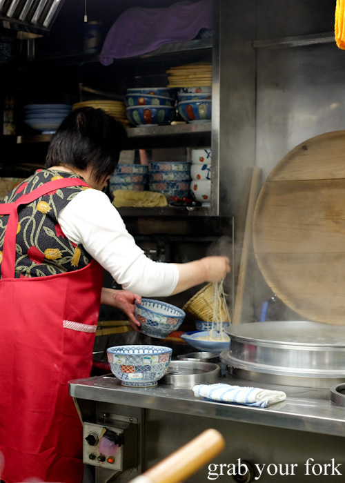 Boiling the fresh soba in a bamboo basket in Otaru, Hokkaido