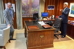 U.S. Secretary of State John Kerry and U.S. Chief of Protocol Ambassador Pete Selfridge look at a desk formerly used by Secretaries of State Henry Kissinger and James A. Baker III while the current Secretary visited the State Department Protocol Office in Washington, D.C., on October 7, 2015. [State Department photo/ Public Domain]