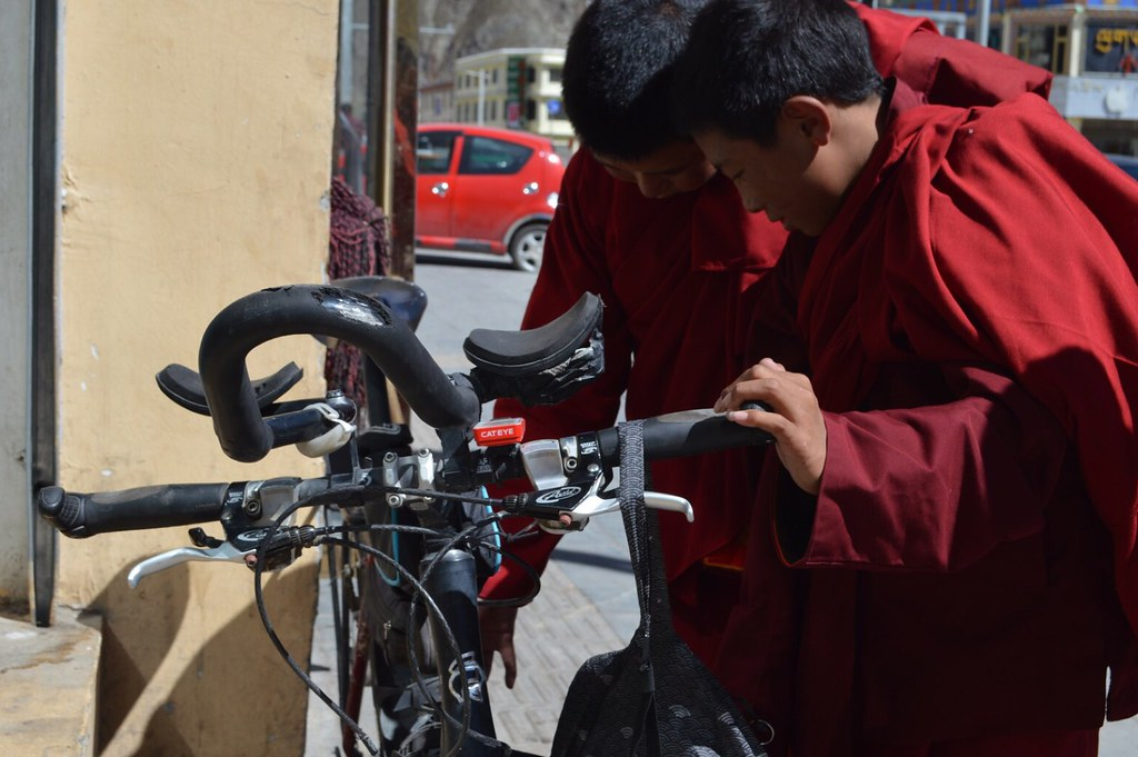 Young Tibetan monks fascinated by my bicycle in Yushu