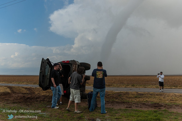 Mon, 11/07/2011 - 15:15 - Storm chaser Andy Gabrielson being helped from his vehicle as tonado moves on to the north - November 07, 2011 3:15:31 PM - Tipton, Oklahoma (34.5364,-99.1078)