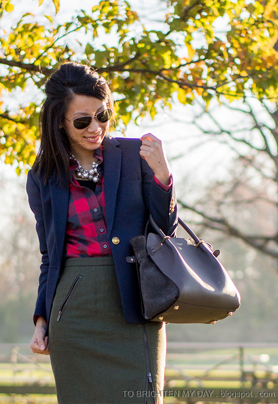 statement necklace, navy blazer, red buffalo check shirt, olive green wool skirt