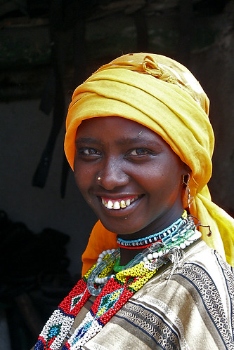 Veiled woman smiling, Harar, Ethiopia by Eric Lafforgue