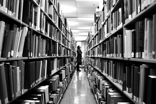 Photo of a person browsing books in the National Library