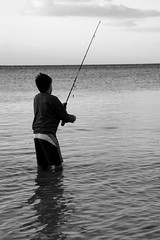 fishing(1.0), sea(1.0), recreation(1.0), casting fishing(1.0), outdoor recreation(1.0), recreational fishing(1.0), monochrome photography(1.0), monochrome(1.0), fisherman(1.0), angling(1.0), black-and-white(1.0),