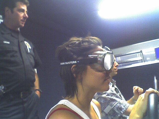 Merci wearing Drunk Busters glasses during a driving simulator