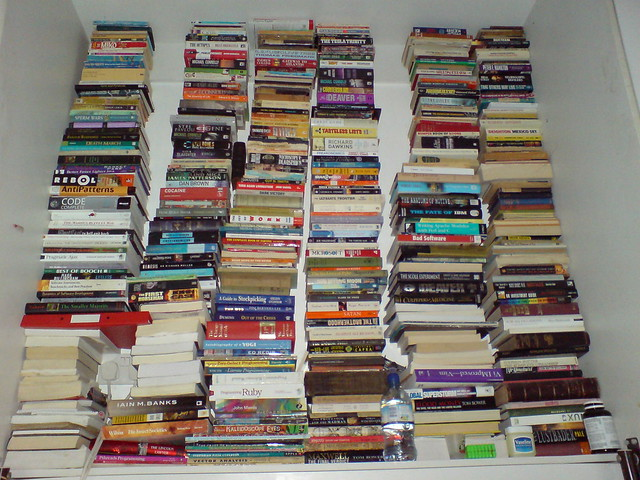 Books behind the bed