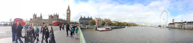 Big Ben and London Eye during the day.