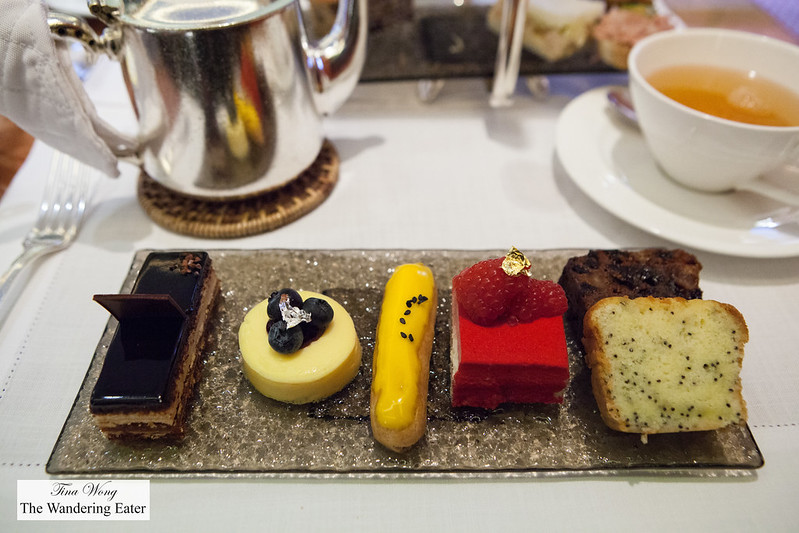 Plate of sweets - Opera cake, blueberry cheesecake, passion fruit eclair, strawberry mousse cake & poppy seed cake