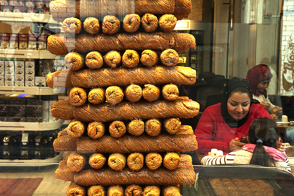 Woman and child in pastry shop--Istanbul