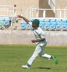 Damion Jacobs returns the ball