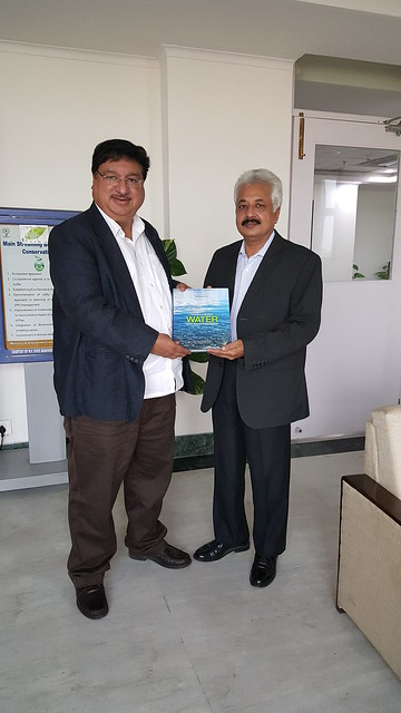 Kamal Nain Pandya presenting the 'Reflections on Managing Water' book to Shri Hem Pande, Special Secretary, Ministry of Environment, Forest & Climate Change, Government of India.