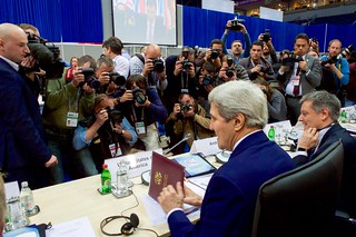 Photographers Take Pictures as Secretary Kerry Arrives at Plenary Session of OSCE Ministerial in Belgrade