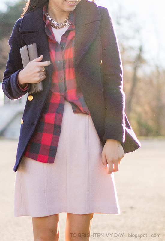 navy peacoat, layered necklaces, red buffalo check shirt, pink wool dress, taupe clutch